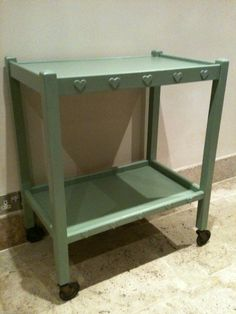 A hostess trolley- salvaged from the tip, sanded down and repainted.I added the wooden hearts too!