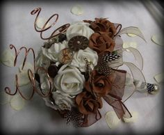 Unique Steampunk bouquet Made with Ivory and chocolate foam roses, heavy copper wire, vintage watch parts, buttons and cabochon. Diy Bouquet, Bride Bouquets, Dream Wedding, Wedding Stuff, Wedding Ideas, Chocolate Roses, Foam Roses, Vintage Buttons, Vintage Watches