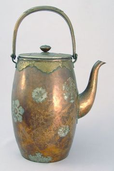 "JAPANESE MIXED METAL TEAPOT: Hammered copper, brass, and silver. Impressed hallmarks. 8 1/2""h."