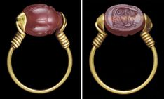 AN EAST GREEK GOLD AND CARNELIAN SCARAB FINGER RING -  ARCHAIC PERIOD, CIRCA LATE 6TH CENTURY B.C.