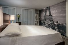 Our Paris removable wall mural looks sensational in this bedroom setting.  The panels simple peel off the backing paper and are applied to the wall.  The matte wallpaper has a high end, fabric finish and the edges butt together for a seamless finish. Removable Wall Murals, Removable Wall Stickers, Living Area, Living Spaces, Traditional Wallpaper, Paris Theme, All Wall, Bedroom Themes, Fabric Wallpaper