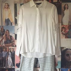 catharine malandrino + blouse Super soft button up blouse with lace inserts on the sleeves and slight hi-low. Truly perfect for any occasion! It's an XS but fits more like a S/M. NWT. Catherine Malandrino Tops Blouses