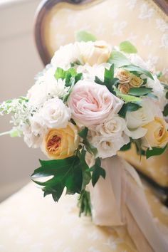 A lovely bouquet full of roses: http://www.stylemepretty.com/2014/11/04/elegant-crane-estate-wedding/ | Photography: Jenny Moloney - http://jennymoloney.com/