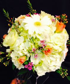 Sweet bouquet with roses, carns and daisies www.bertholdsflowers.com