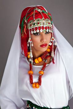 Africa |  Portrait of a Berber / Amazigh woman  (Bint - daughter ..al Maghreb - of Morocco ...Translation from Arabic)