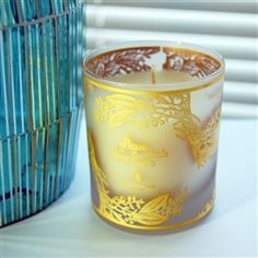 Alvarez Gomez candle in frosted glass votive with gold illustration.