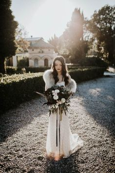 Winter Bridal Style with Fur Stole and Dark Makeup