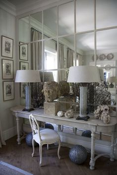 I really like this mirrored wall. Could enlarge a small space.