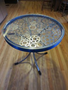 I really want to make this bike rim table | Recycled Bike Part End Table E by WeldedBikeArt on Etsy