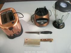 Copper Toaster and Blender with Two Henkel Knives. Sold on MaxSold for $105
