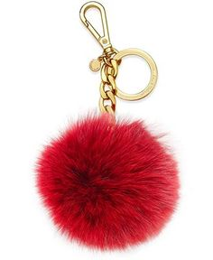 Pop this fox fur key fob onto your handbag for a shot of style and a convenient place to keep your keys. From Michael Michael Kors. | Imported | Pieced, dyed fox fur | Fur origin: China | Key ring; ca