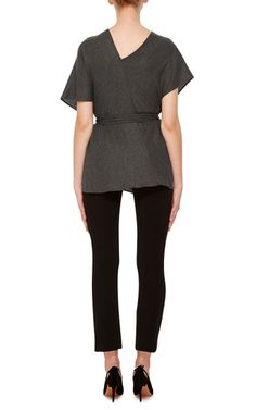 **Hensely** crafted this structured top in a wrapped design evocative of a…