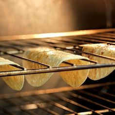 Make Taco Shells With Tortillas. Working with 6 tortillas at a time, wrap in a barely damp cloth or paper towel and microwave on High until steamed, about 30 secs. Lay the tortillas on a clean work surface and coat both sides with cooking spray. Then carefully drape each tortilla over two bars of the oven rack. Bake at 375 F until crispy, 7 to 10 minutes.