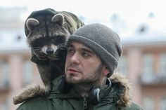 A man and his pet racoon on his shoulders in central Kiev, Ukraine- The Atlantic