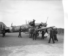Ground crew take over Hawker Typhoon Mark IB, DN374 'US-A', of No. 56 Squadron RAF, in order to prepare it for another sortie, as the pilot, Flying Officer R Poulter, unbuckles himself from the cockpit on his return to Matlaske, Norfolk.