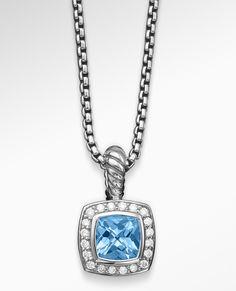 The diamond border on this Albion® pendant amplifies the sparkle of blue topaz. David Yurman