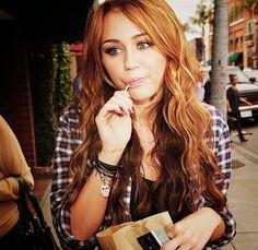 Miley Cyrus' long, wavy auburn locks