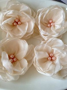 Organza flowers 6 pcs. ivory organza flowers  with pink pearls. $12.00, via Etsy.