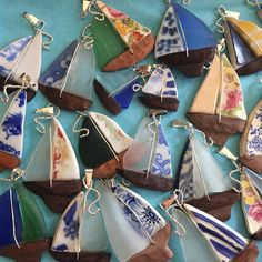 Antique China, Sea glass and Driftwood Sailboat necklace. The left sail is a piece of frosted white glass, collected along the shores of the Chesapeake Bay. The right sail was hand cut and shaped from antique Fiestaware pottery. I made the white lines myself using my cutting stone
