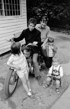 Bob Dylan and John Sebastian(on back of Triumph), and the Paturel children, in the alley behind Cafe Espresso -1964