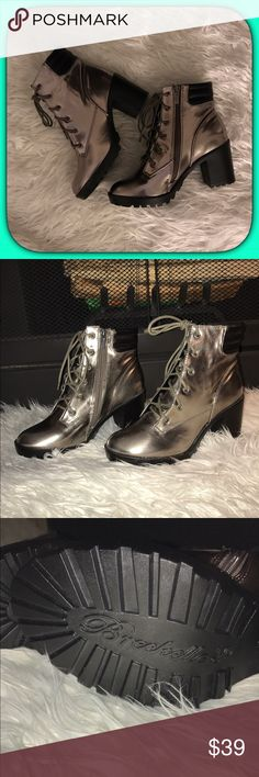 """New Listing""Gun Metal Gold Ankle Booties Function meets style in these ruggedly chic booties. They boast a comfortable padded collar, classic laces and atreaded sole for sure-footed strides. A chunky heel adds a boost of height. ""Note last pic is only an example photo & not for sale"" NEW LISTING ARE NOT APART OF THE NAME YOUR PRICE SALES EVENT  3'' heel 4'' shaft 10'' circumference Lace-up / side zip closure Man-made Imported Breckelles Shoes Ankle Boots & Booties"
