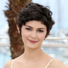 French actress Audrey Tautou kicked off Cannes Film Festival 2013 in style, teaming a cute Valentino sundress with her infamous curly crop. This short hairstyle is perfect for fine, limp curly hair as the layers add extra volume.