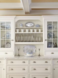 Glass cabinets with drawers underneath. Gorgeous blue willow dishes in Kitchen Traditional with Wall Plate Rack next to Dining Room Cabinet alongside Plate Drawer and China Cabinet Kitchen Cabinets Decor, Cabinet Decor, Kitchen Pantry, New Kitchen, Kitchen Storage, Plate Storage, Dish Storage, China Kitchen, Kitchen Backsplash