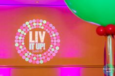 Liv it Up logo at Olivia's colorful, jewel-toned, balloon-filled Bat Mitzvah party at Hyatt Regency Dulles. Pink, purple, teal, turquoise and gold. | Pop Color Events | Adding a pop of color to Bar & Bat Mitzvahs in DC, MD & VA | Photo by Sweet Dreams Studios