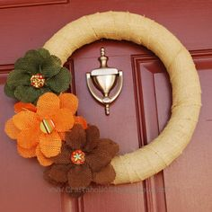 Like the Fall Wreath with Felt Rosettes (minus the Felt Rosettes), Fall Grapevine Wreath, Fall Pumpkin Wreath.