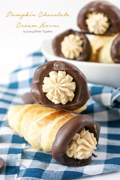 These Pumpkin Chocolate Cream Horns are a simple flaky pastry shell filled with smooth pumpkin cream and dipped in dark chocolate.
