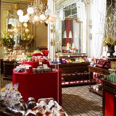 A cafe/ coffee shop? Absolutely! Demel Vienna, in Vienna Austria, is a delicious, fabulous, gorgeous, yummy gem. In the 1700's they baked for the Royal Court of Austria-Hungry and it is still that good. To die for pastries, chocolates, coffees, hot chocolate, egg dishes, sandwiches, vienna sausage, souffles,sweetbreads- everything made by the chef using no machinery at all. Expensive, decadent, and worth it. Oh, try the Sachertorte, of course, which Demel claims they invented.