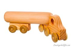 Our Natural & Organic Wooden Tractor Trailer Truck with Tanker Trailer is part of our Eco-friendly Wooden Toy line and is lovingly hand-crafted at our wood shop. Measures approximately 17 inches long and is made from Fir with Hard Maple wheels. Featuring over-sized parts, rounded edges and corners, and sanded smooth. Finished with our Natural, Non-Toxic Beeswax Finish to a silky smooth finish. Completely handmade in the USA with pride. 100% Natural & Organic Wood with Natural, Non-Tox...