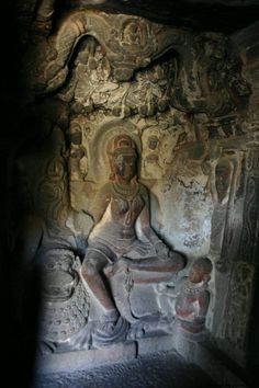 "An imposing Yakshi, Ambika, is seated on her lion under a mango tree, laden with fruits."" from Ellora  Cave 34; of the Ellora Caves"
