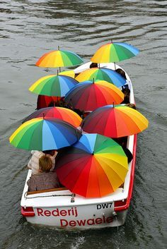 ☆ Ghent, Belgium umbrellas - a boat full of rainbow umbrellas :-)
