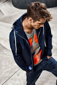 Orange and gray t-shirt with jeans and blue hoodie, relaxed style for men
