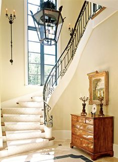Inviting entryways feature decorating wrought iron staircase railing that ranges from simple to swirly. Iron Staircase Railing, Staircases, Grand Staircase, Grades, Foyer Decorating, House Stairs, Entry Foyer, Interior Exterior, Interior Design