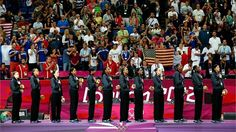 Players from the United States stand on the podium during thenational anthem after they received their gold medals during the Victoryceremony for the Women's Basketball on Day 15 of the London 2012 Olympic Games at North Greenwich Arena