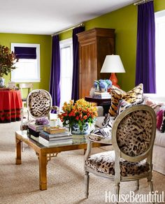 "Benjamin Moore's Split Pea. ""I love green and purple together,"" designer Sam Allen says. ""It's very Palm Beach."" Chairs in a Cowtan & Tout fabric. Curtains in a Kravet velvet."