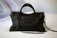 My Ten Essential Closet Pieces Perfect black bag.  Unadorned and logo-free