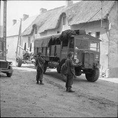 AEC Matador artillery tractor, named 'Gazala', towing a 5.5-inch gun through a village, 1 July 1944.