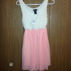 Dress-- New with tag! Wet Seal brand. New with tags (never worn!) Size medium. Wet Seal Dresses