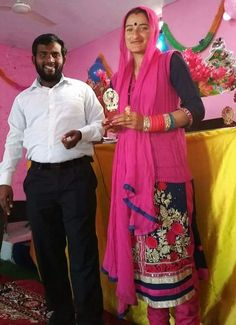 FIERY ORDEAL FOR PASTOR, CHURCH, WIDOWER IN JAMMU KASHMIR STATE, INDIA - Seema Devi and Pastor Jeewer Joeswa at Christmas Day service. (Morning Star News)