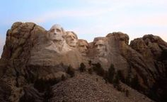 Low Angle View Of Mount Rushmore Against The Sky - Caelan Stulken / EyeEm/Getty Images