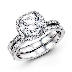 Simon G 18K White Gold Halo Engagement Ring With 0.40 Carat Diamondshttp://www.bengarelick.com/collections/simon-g/products/simon-g-18k-white-gold-halo-engagement-ring-with-0-40-carat-diamonds