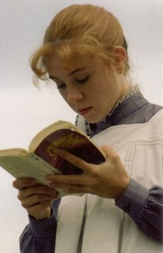 "Megan Follows as Anne Shirley, reading ""Anne of Green Gables""."