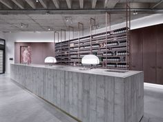 Textures and tones are balanced in einszu33's stage for Aesop products via Frameweb.com