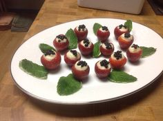 White Chocolate Mint Leaves and Strawberries with With Chocolate Mascarpone Cream topped with Balsamic Caviar