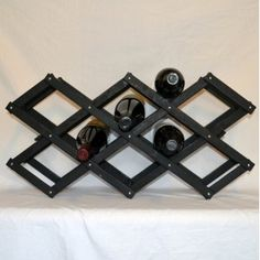 Black wood accordion or collapsible style wine rack