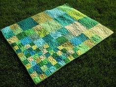 Beautiful quilt in greens and blues using all solids by Pippa Patchwork