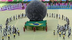 Performers take part in the opening ceremony of the 2014 FIFA World Cup at the Corinthians Arena in Sao Paulo on June 12, 2014, prior to the opening Group A football match between Brazil and Croatia
